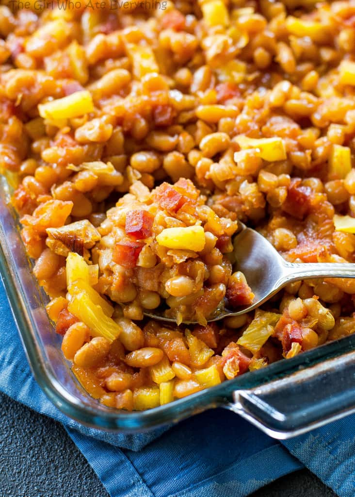 Hawaiian Baked Beans - sweet and salty with bits of ham throughout!. A great side for luaus or BBQs. the-girl-who-ate-everything.com