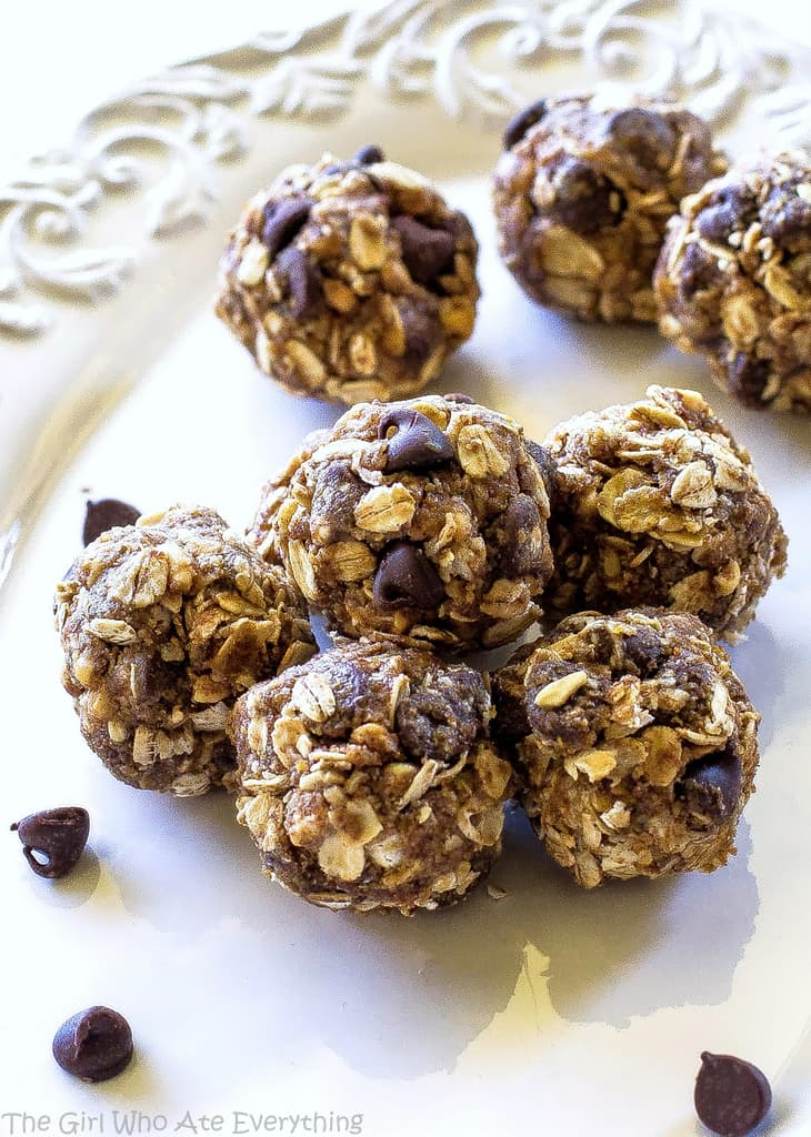 Easy Energy Balls - oats, honey, flaxseed, peanut butter, and a few chocolate chips. We make this easy snack once a week at least! the-girl-who-ate-everything.com
