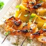 These Grilled Shrimp and Pineapple Skewers are served over coconut rice and have a sweet Teriyaki glaze. the-girl-who-ate-everything.com