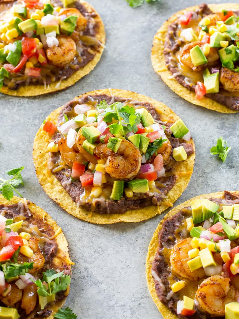 Shrimp Tostadas with black beans, avocado, onions, tomatoes, and cilantro. the-girl-who-ate-everything.com