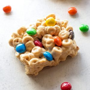 Cheerio Treats - an easy no-bake recipe with cheerios, marshmallows, peanut butter, and M&Ms. the-girl-who-ate-everything.com