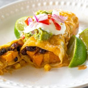 Sweet Potato and Black Bean Enchiladas - a vegetarian Mexican dinner that has the perfect amount of spice and flavor. This is a great freezer meal! the-girl-who-ate-everything.com