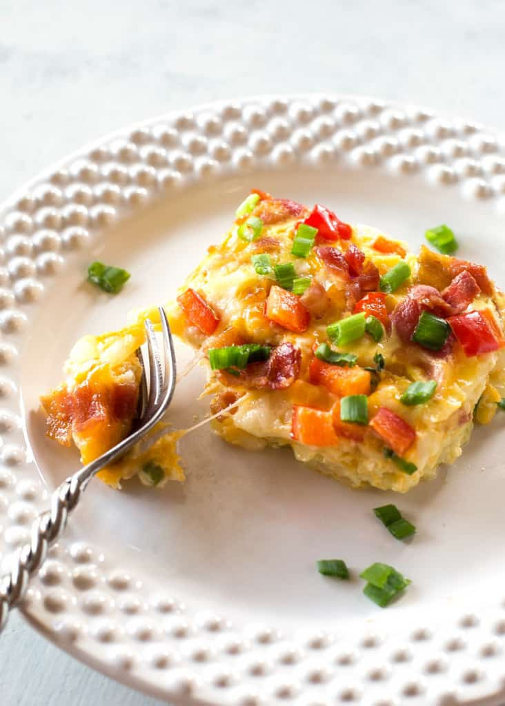 Confetti Bacon Hashbrown Casserole - a great breakfast for entertaining filled with cheesy hash browns, eggs, chiles, green onions, and red bell pepper. the-girl-who-ate-everything.com