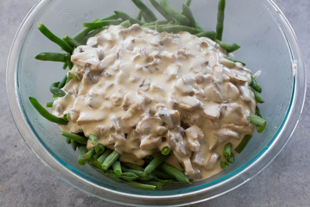 This homemade Green Bean Casserole recipe made without cream of mushroom soup. Easy and delicious side for Thanksgiving or any other holiday. the-girl-who-ate-everything.com