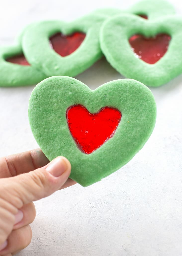 These Grinch Heart Cookies are magical little treats that you can make at Christmas with your kids. the-girl-who-ate-everything.com