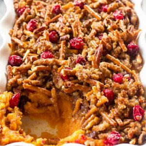 Pretzel Cranberry Sweet Potatoes - sweet potatoes topped with a sweet brown sugar pretzel topping and tart cranberries.