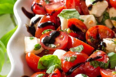 This Marinated Caprese Salad is a great side dish. Marinated in balsamic dressing and herbs, it has so much flavor.