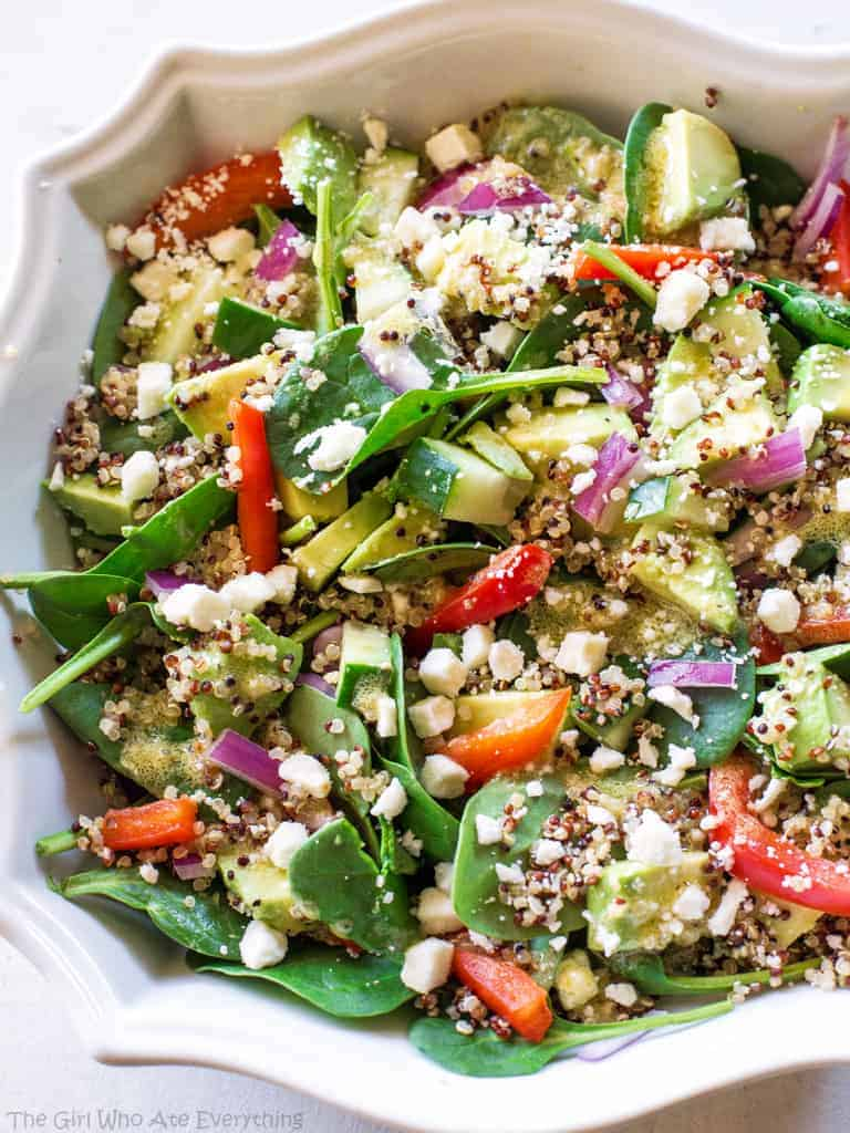 Spinach Quinoa Salad with red bell pepper, avocado, cucumber, onion, and feta