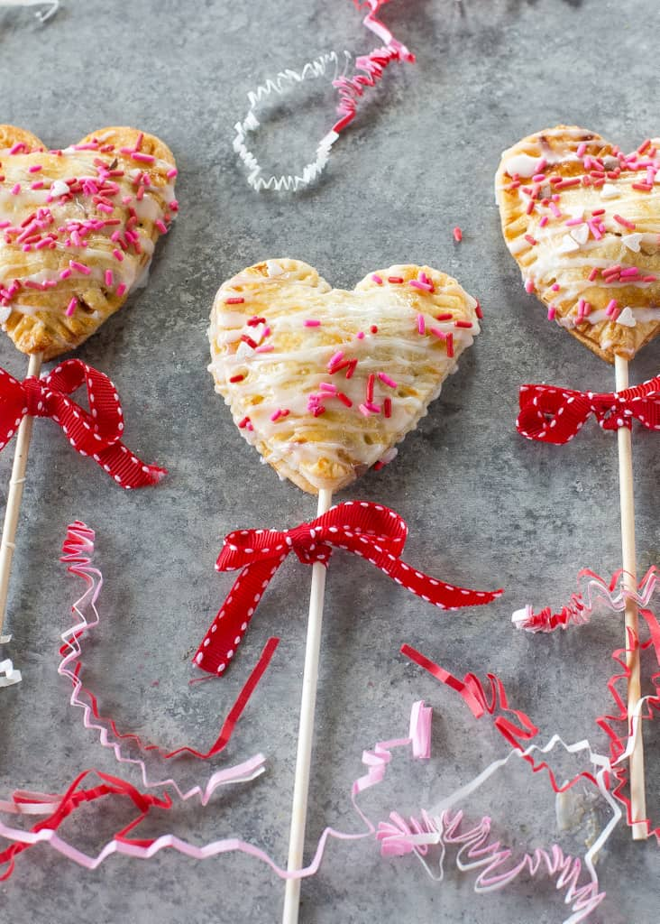 Apple Pie Pops with powdered sugar glaze and sprinkles