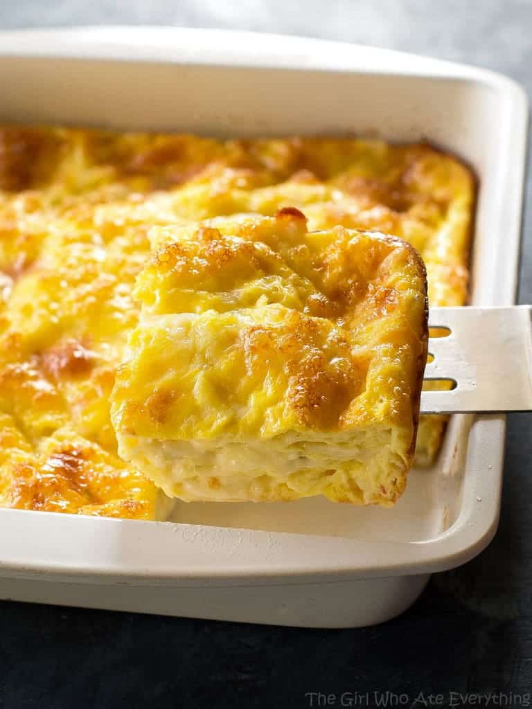 Cheesy Baked Eggs slice in a white pan