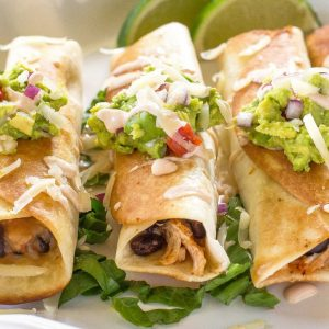 Chicken and Black Bean Flautas on a plate