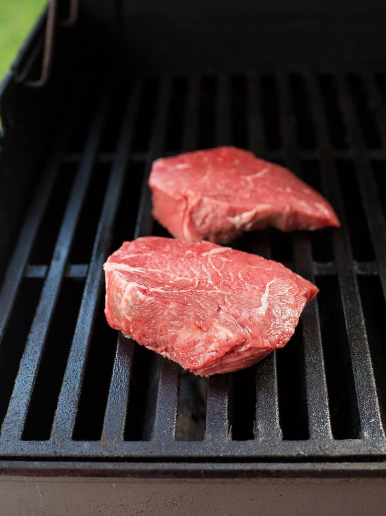 sirloin steak on a grill
