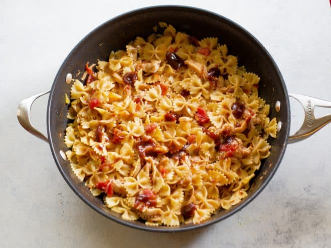 tomatoes and pasta in a pan