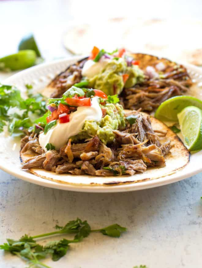 carnitas with sour cream and guacamole