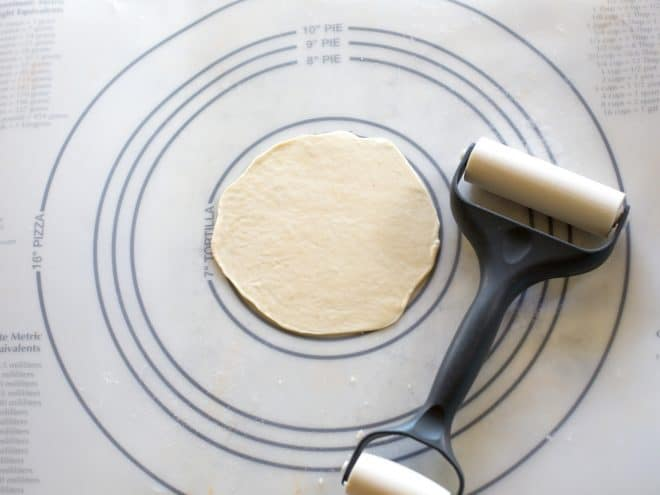 tortilla dough being rolled out