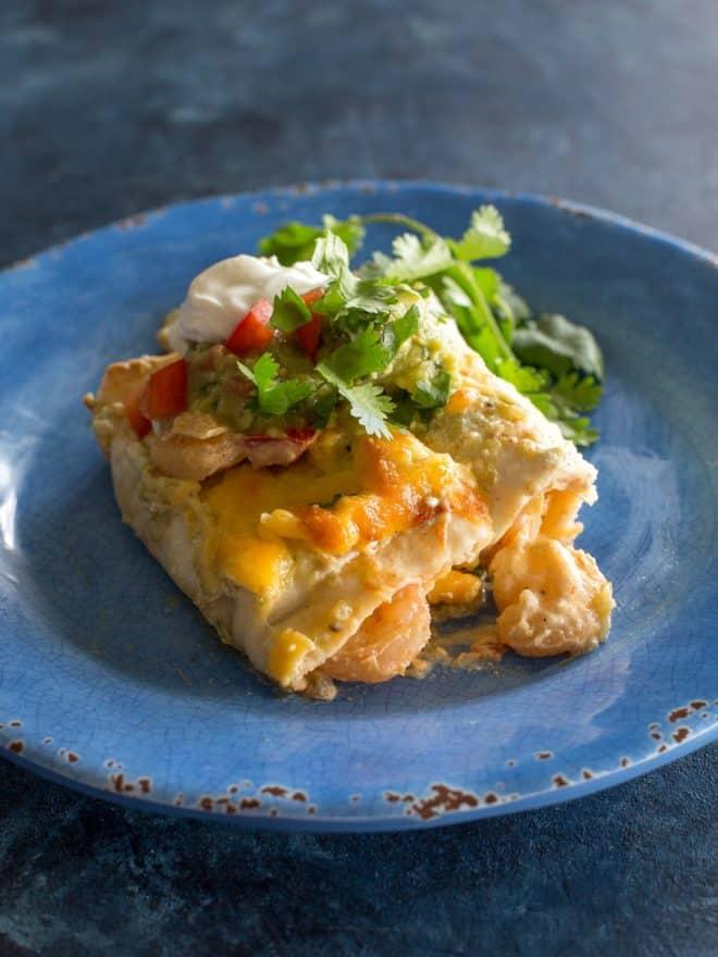 shrimp enchiladas on a blue plate