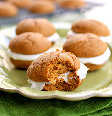 These Pumpkin Whoopie pies have a cream cheese filling inside. These Pumpkin Whoopie Pies have the perfect amount of spice and are made easy from a cake mix.