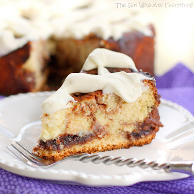 This Cinnamon Roll Cheesecake is cheesecake with cinnamon roll dough base and buttery cinnamon swirled throughout. The top is frosted with thick cream cheese frosting. the-girl-who-ate-everything.com