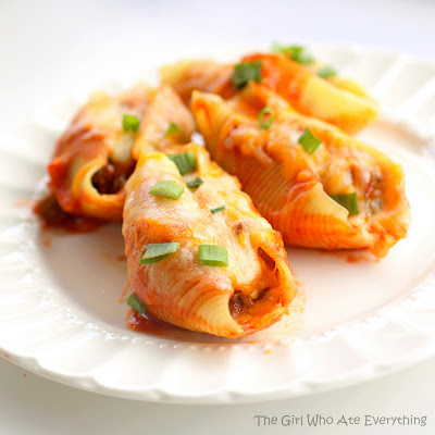 Mexican Stuffed Shells - Pasta Shells stuffed with taco meat and cheese. An easy dinner for a busy night. Freezes well too! the-girl-who-ate-everything.com