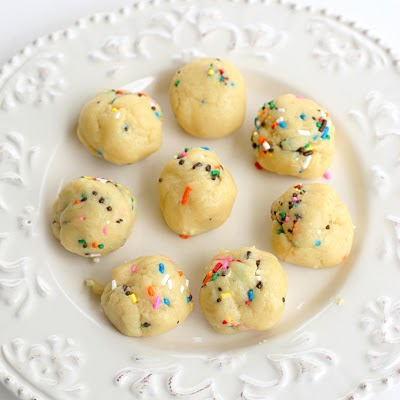 Cake Batter Truffles - cake batter flavored edible dough dipped in vanilla coating and lots and lots of sprinkles. the-girl-who-ate-everything.com