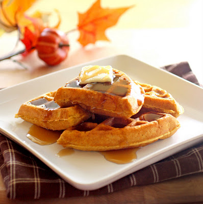 These pumpkin waffles are packed with spices and taste like fall for breakfast! the-girl-who-ate-everything.com