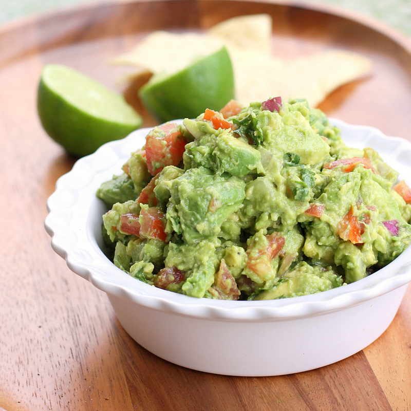 Homemade Guacamole Recipe with tomatoes, onions, and cilantro