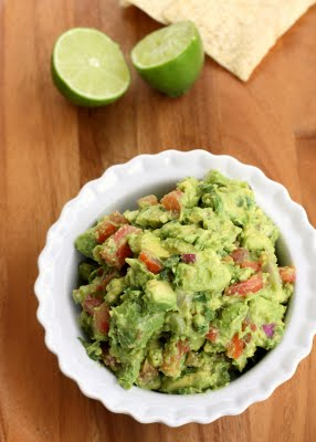 Homemade Guacamole with avocados, tomatoes, onions, and lime.