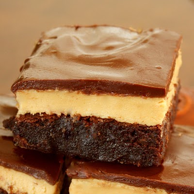 Peanut Butter Truffle Brownies - Sometimes called Buckeye Brownies and so worth every calorie. the-girl-who-ate-everything.com