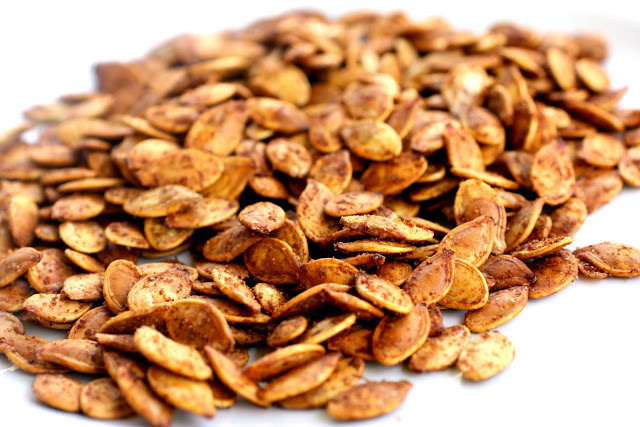 Roasted Pumpkin Seeds are easier than you think. If you've ever wanted to know how to roast pumpkin seeds, I'll teach you. This roasted pumpkin seeds recipe are crispy and full of seasoning! #pumpkin #seeds the-girl-who-ate-everything.com