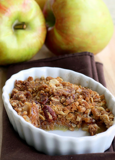 This Perfect Apple Crisp is one that we claim as the best. It's 9x13 pan full of sweetened apples and a thick crumble layer with brown sugar and oatmeal. the-girl-who-ate-everything.com