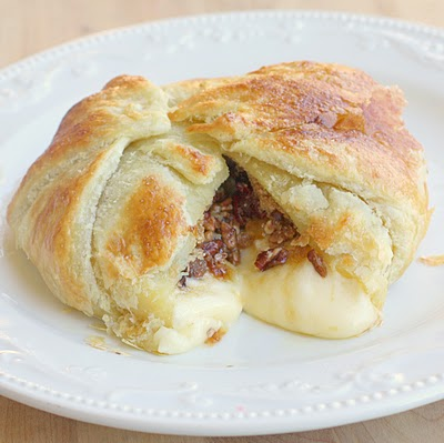 This Brie En Croute might be one of my all time favorite appetizers. Layers of flaky pastry dough, brie cheese, brown sugar, and cinnamon pecans.
