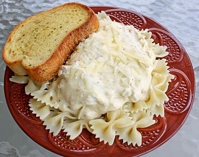 Crockpot Italian Chicken over pasta and garlic bread